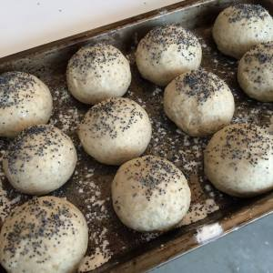Unbaked rye rolls with poppy seeds