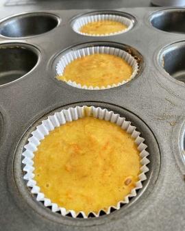 Carrot muffin batter in tin
