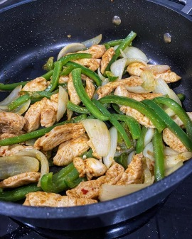 Chicken fajitas in pan